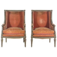 Pair of Louis XVI Carved and Painted Walnut Bergeres a L'Oreilles, 18th Century