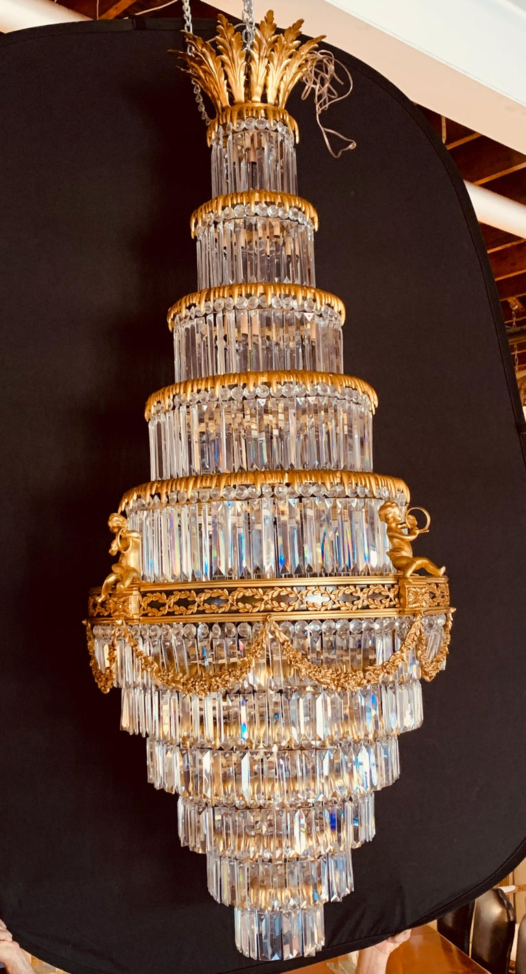 Hollywood Regency Pair of Louis XVI Style Gilt Bronze and Crystal Swag Neoclassical Chandeliers For Sale