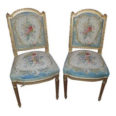 A Pair of Louis XVI Style Gilt Petit Point Embroidered Chairs