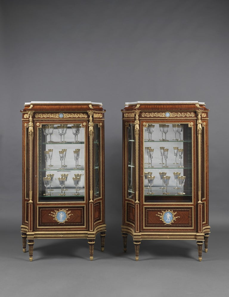 An important pair of Louis XVI style gilt-bronze mounted vitrines with wedgwood Jasperware plaques, by Joseph-Emmanuel Zwiener.