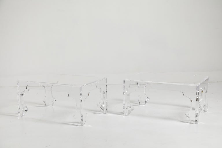 A clean and sparkling pair of low tables fabricated in Lucite. They have all the details of a wood table but they have been fabricated entirely in acrylic. These may indeed be one offs. Super stylish and easily worked into both modern or traditional
