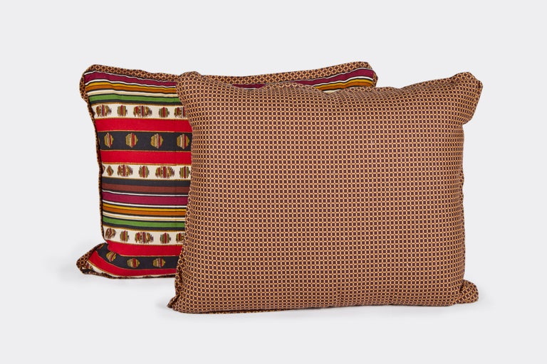 A pair of colorful lumbar cushions made with vintage Madeleine Castaing printed cotton fabric in a striped pattern, based on a 19th century document textile. The fabric on the back is a woven cotton blend. Cushions use vintage fabric, but are newly
