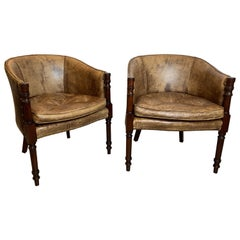 Pair of Mahogany and Distressed Leather Tub Chairs