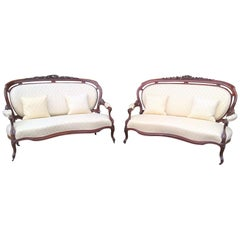 Pair of Mid-19th Century Continental Carved Mahogany Framed Serpentine Sofa's