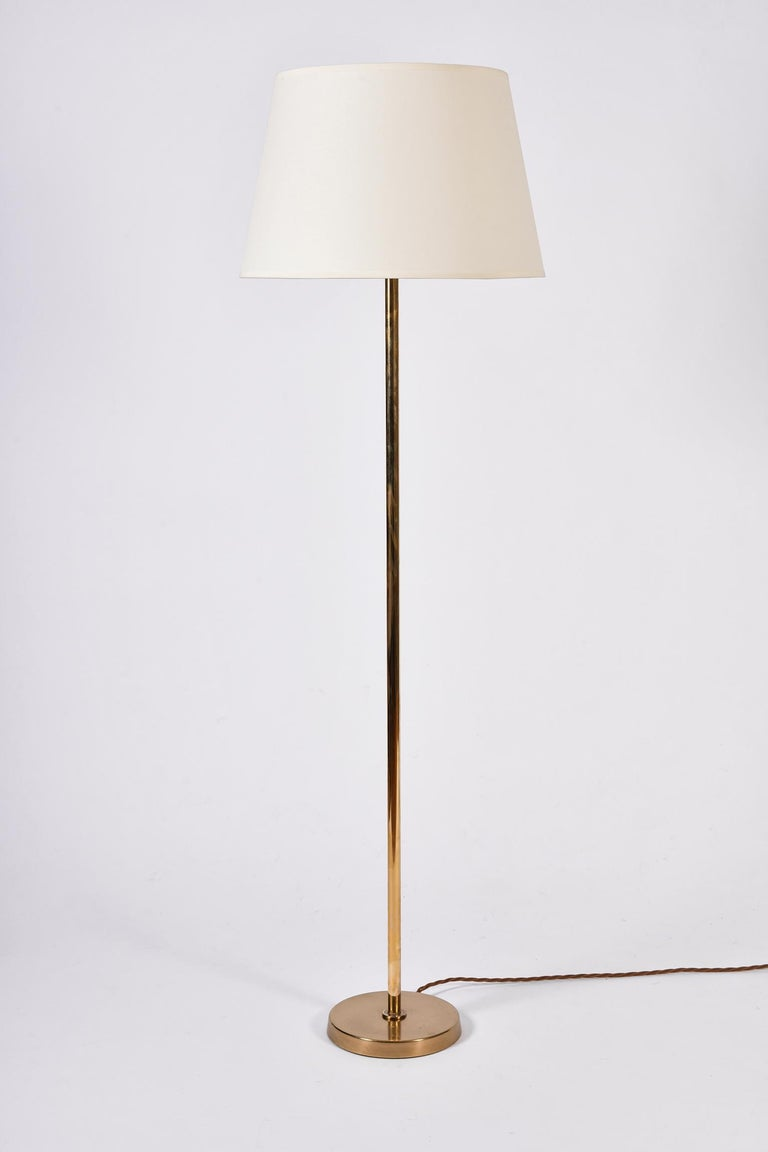 A pair of brass floor lamps by Bergboms