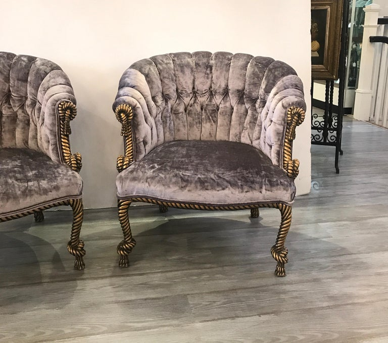This pair of Classic Hollywood Glam carved giltwood rope and tassel tub arm chairs, Italy, 1960s. High decorator style with new lavender velvet fabric.