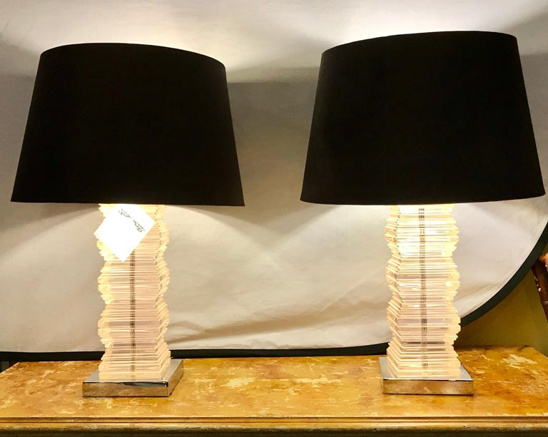 A pair of Mid-Century Modern stacked lucite table lamps. Shades not included.