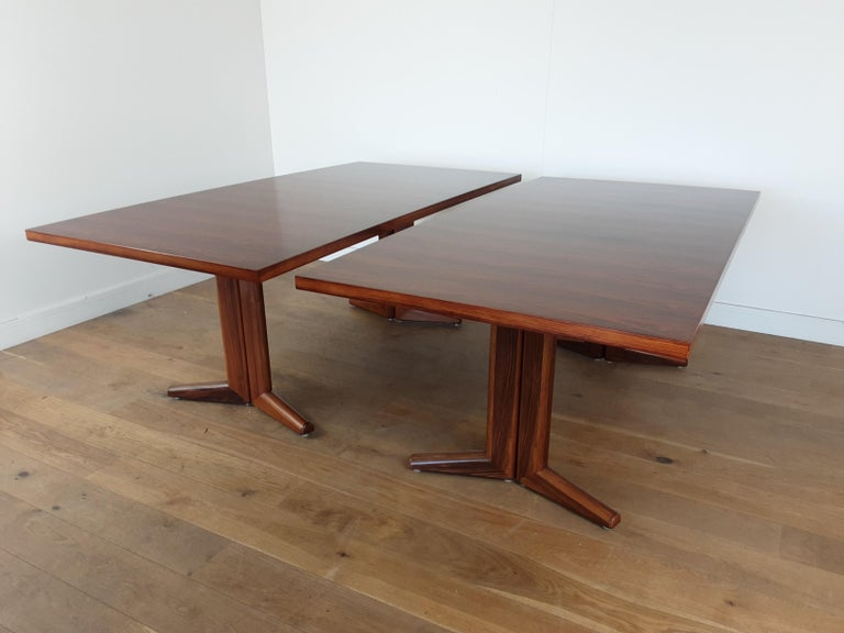 A pair of rosewood dining tables designed by Martin Hall for Gordon Russell. Midcentury dining tables in a stunning rosewood. each table is 75 cm H 198 cm W 99 cm D British, circa 1980.  Provenance : These tables were removed from the storage
