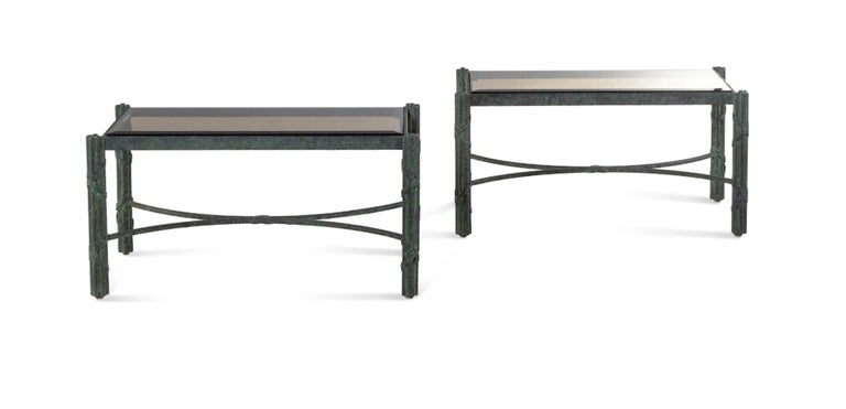 A pair of modern patinated bronze smoky glass-top low tables/benches These are currently low tables but could easily have a cusion made making them a pair of benches. Priced per table/bench. 20th century Measures: Height 18 x width 35 3/4 x depth
