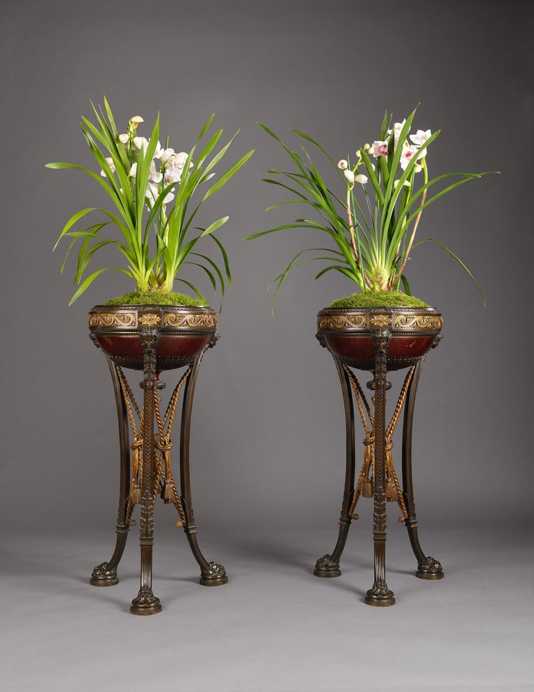 A fine pair of Napoléon III gilt bronze and patinated bronze Athéniennes modelled in the classical antique style, attributed to Barbedienne.  French, circa 1870.  The bronze impressed with the number R 2571 and R 2572.   This fine pair of