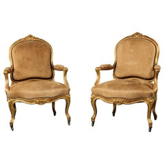 Pair of Louis XV Style Carved Giltwood Fauteuils