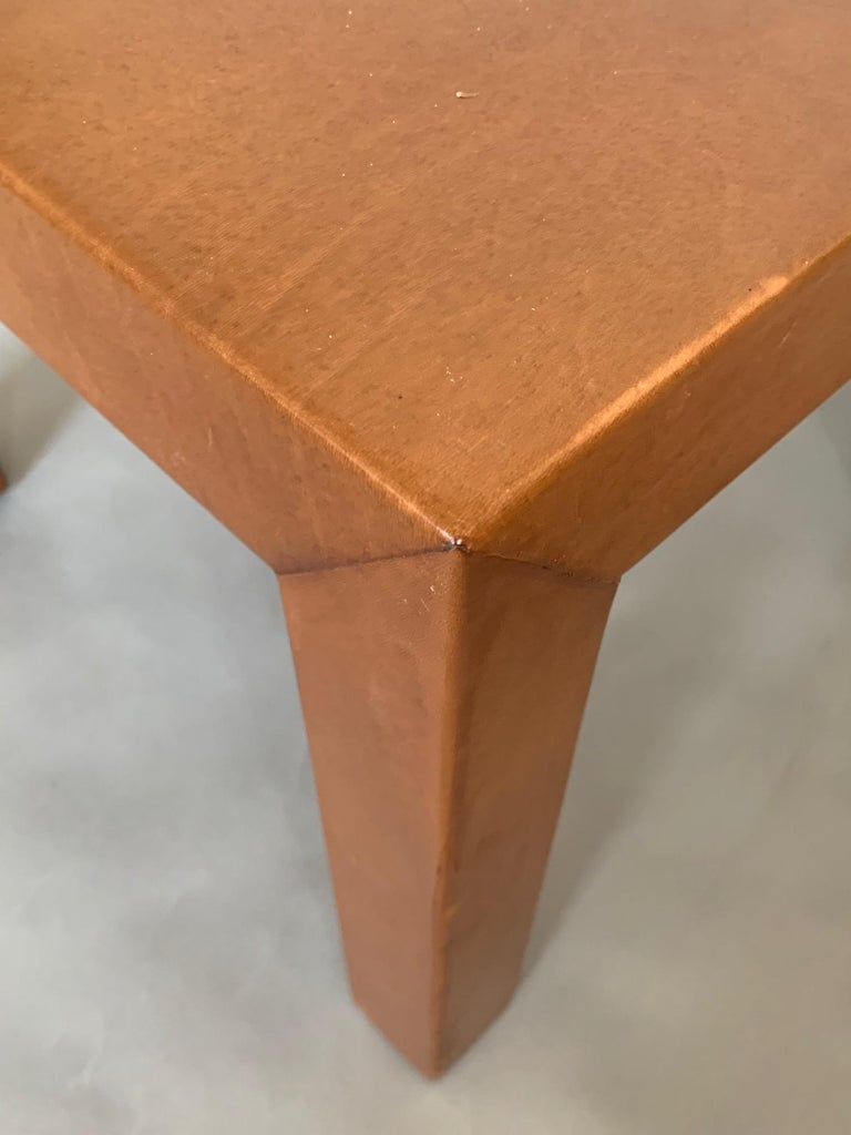 A pair of custom occasional tables done in cognac leather by MHG Studio.