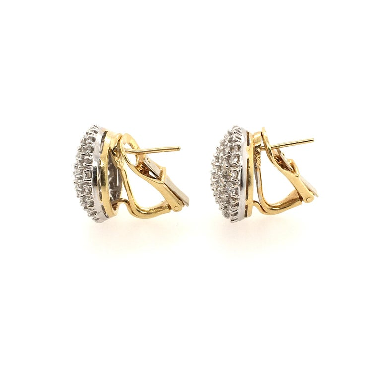 A pair of 18 karat yellow gold and white gold and diamond earrings . Designed as a pave set diamond bombe dome, with clip backing. Diamonds weigh approximately 5.00 carats total. Diameter is approximately 5/8 inches, gross weight is approximately