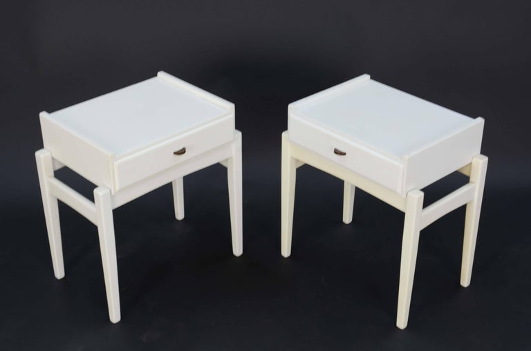 Featuring the signature Lovig drawer pull are these night stands in a white lacquered finish.
