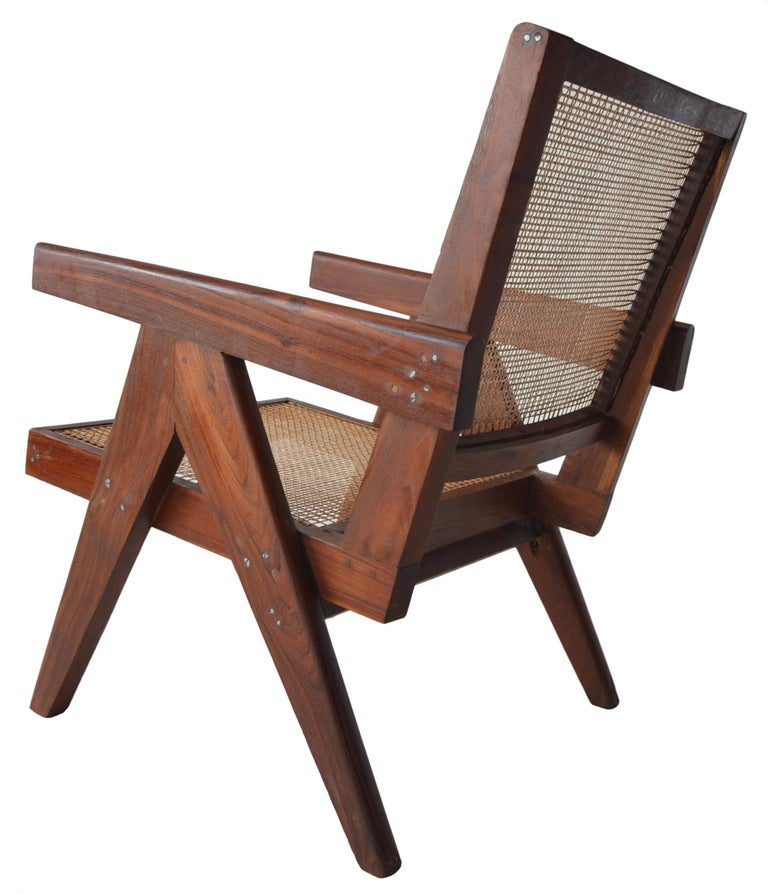 A great pair of easy chairs by Pierre Jeanneret for the Chandigarh project. In a very rare and desirable Sisso Rosewood. This pair is lightly and sympathetically renovated. A simple cleaning and waxing was performed to bring out the color and grain