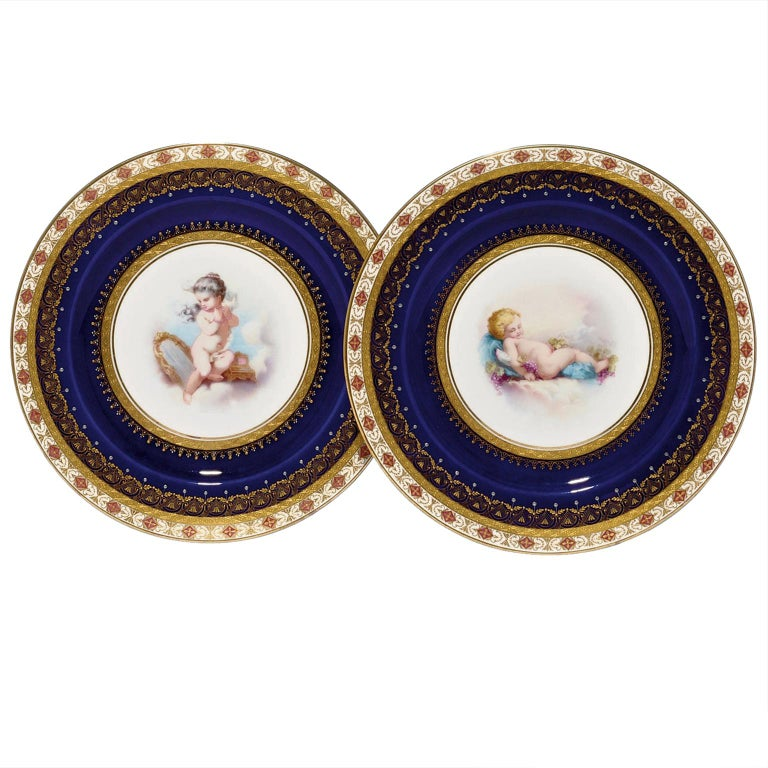Pair of Porcelain Plates Depicting Putto at Play by Minton, Dated 1881 For Sale