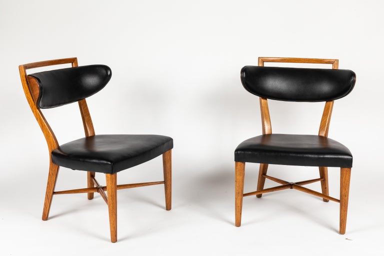 A chic and useful pair of pull up chairs in original upholstery and finish ready to be customized by you, or used as is. Very much in the style of designers like Billy Haines these chairs have style to spare. Original finish in Fine condition.
