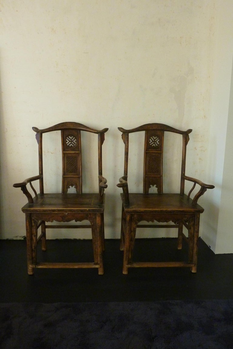 A pair of Qing dynasty hand carved elm wooden chairs from the Shanxi Provence late 19th beginning 20th century.