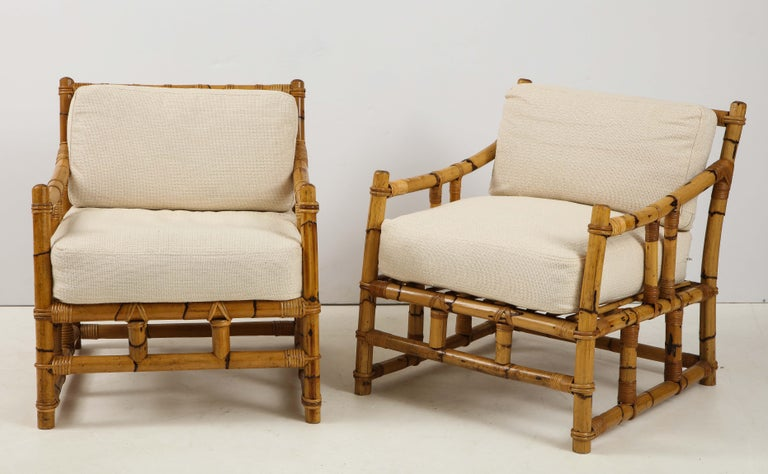 Enjoy summer all year round with this fabulous pair of vintage rattan chairs from France! Very well constructed and sturdy, the chairs have a wonderful warm color and feature neutral toned seat cushions.