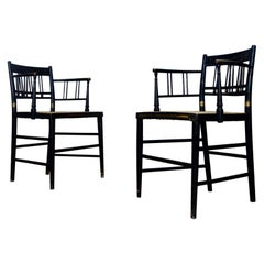 Pair of Regency Ebonized Gilded Armchairs, Caned Seat