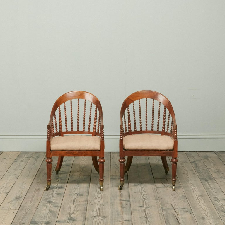 Hand-Carved Pair of Regency Faded Rosewood Library Armchairs For Sale