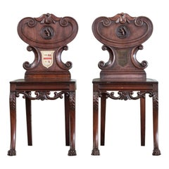 Pair of Regency Mahogany Armorial Hall Chairs, with Unusual Carved Squirrels
