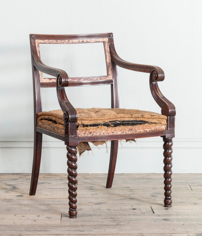 A pair of Regency mahogany side chairs.