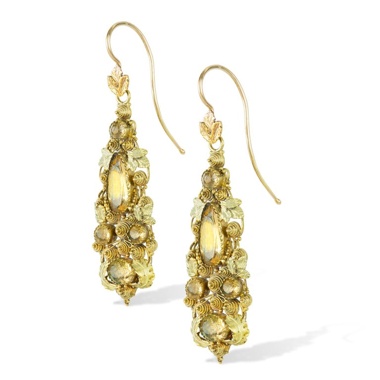A pair of Regency yellow gold and gem-set cannetille earrings, the golden topaz earrings set within three colour gold cannetille work in a foliate style, with gold hook fittings, circa 1820, measuring approximately 4.5 x 1.4cm, gross weight 6.5