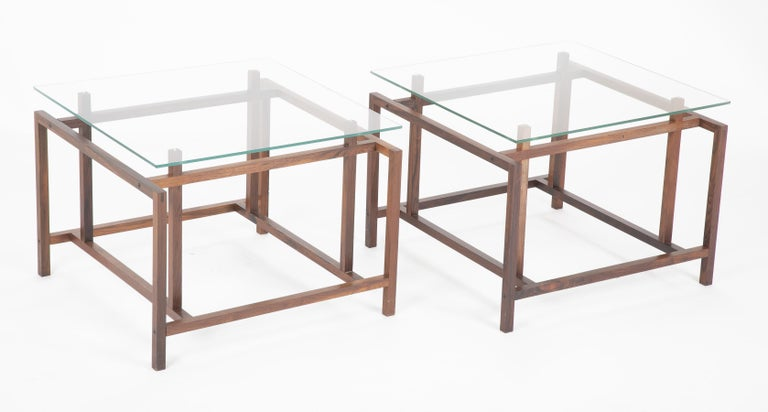 A pair of Danish Mid-Century Modern side tables designed by Henning Noraard for Komfort. Rosewood with original glass tops.
