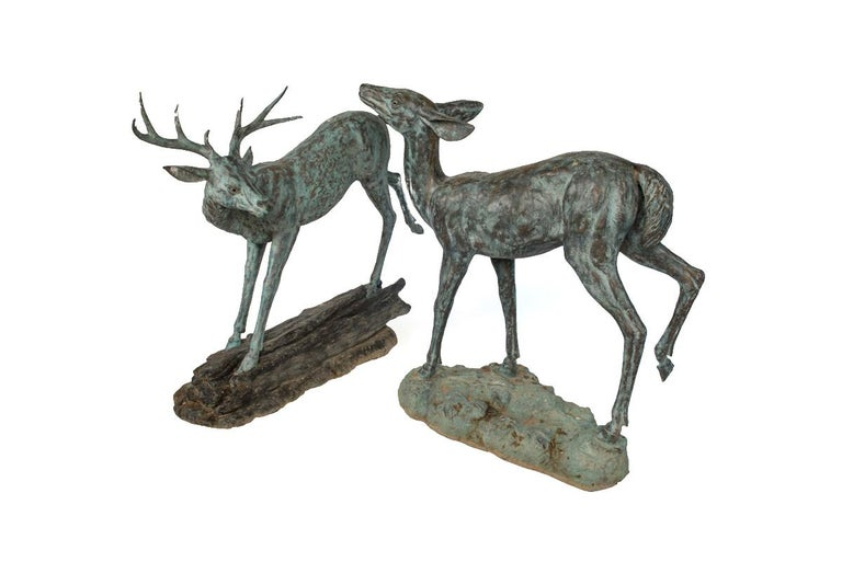 Sculptural bronze depiction of a stag and his mate. The ornate detail reflects the quality of these bronze statues. Dimensions are: Stag: 58