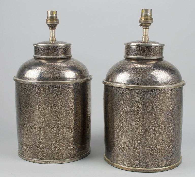 Fine pair of small Chinese silver shagreen porcelain tea canisters, now mounted as table lamps.  Height of canisters: 11 in (28 cm)  All of our lamps can be wired for use worldwide.  We can supply a selection of card, linen or silk lampshades