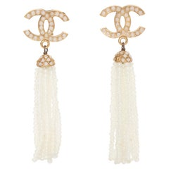 A Pair of Silver-Toned Vintage Chanel Dangle Earrings With White Beading