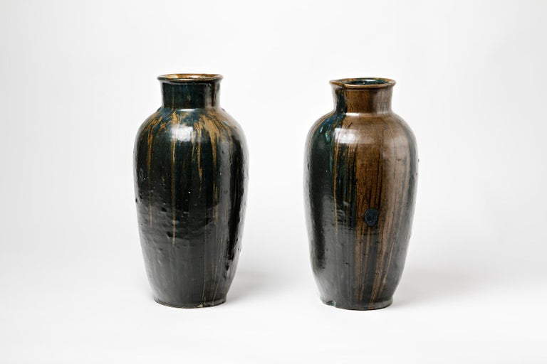 A pair of stoneware vase by Leon Pointu (1879-1942)