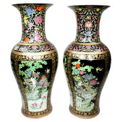 A Pair of Tall Chinese Export Porcelain Figural Vases with Birds and Flowers