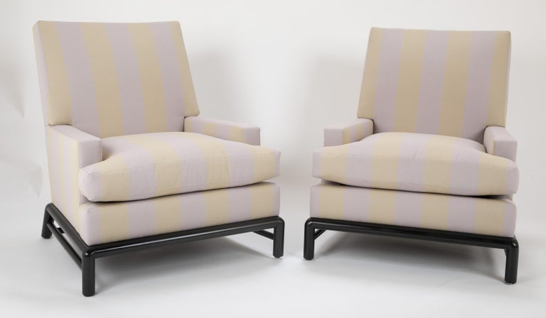 A pair chairs designed by T.H. Robsjohn Gibbings, upholstered in Rogers & Goffigon fabric. Newly upholstered with down cushion.