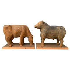Pair of Two Swedish Carved Folk Art Sculptures of a Bull and Cow