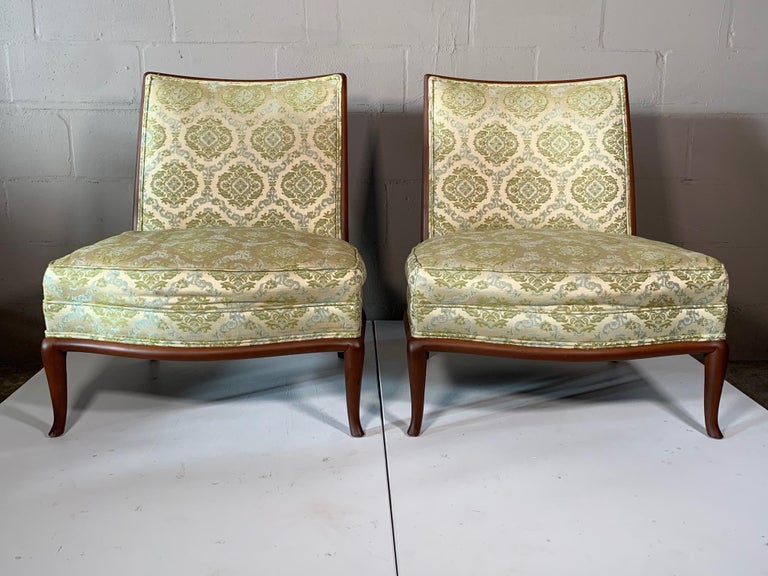 A pair of rare and unusual French style slipper chairs by T.H. Robsjohn-Gibbings for Widdicomb, circa 1950s.