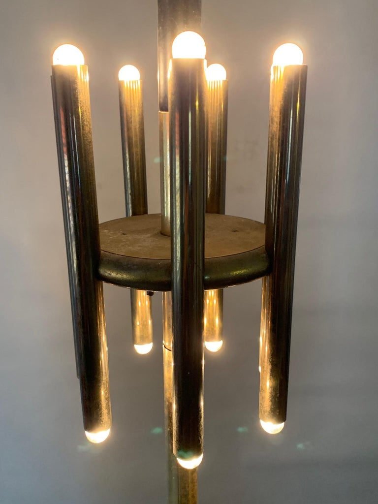A great pair of vintage brass pole lamps. In the style of Lightolier or Stilnovo these have a lot of presence and style. Height adjusts to 107
