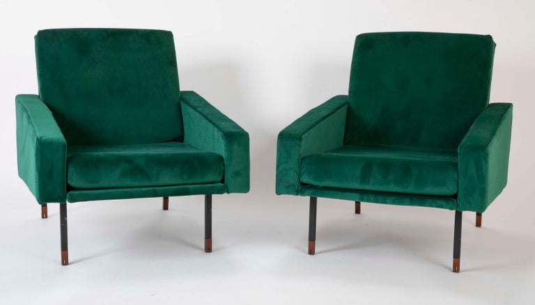 A pair of Italian Mid-Century armchairs in emerald green ultra-suede. Blackened steel frame tipped with walnut feet.