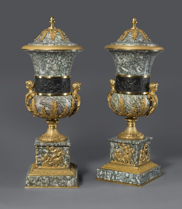 A pair of gilt and patinated bronze mounted verde chassagne marble vases and covers.  French, circa 1890.