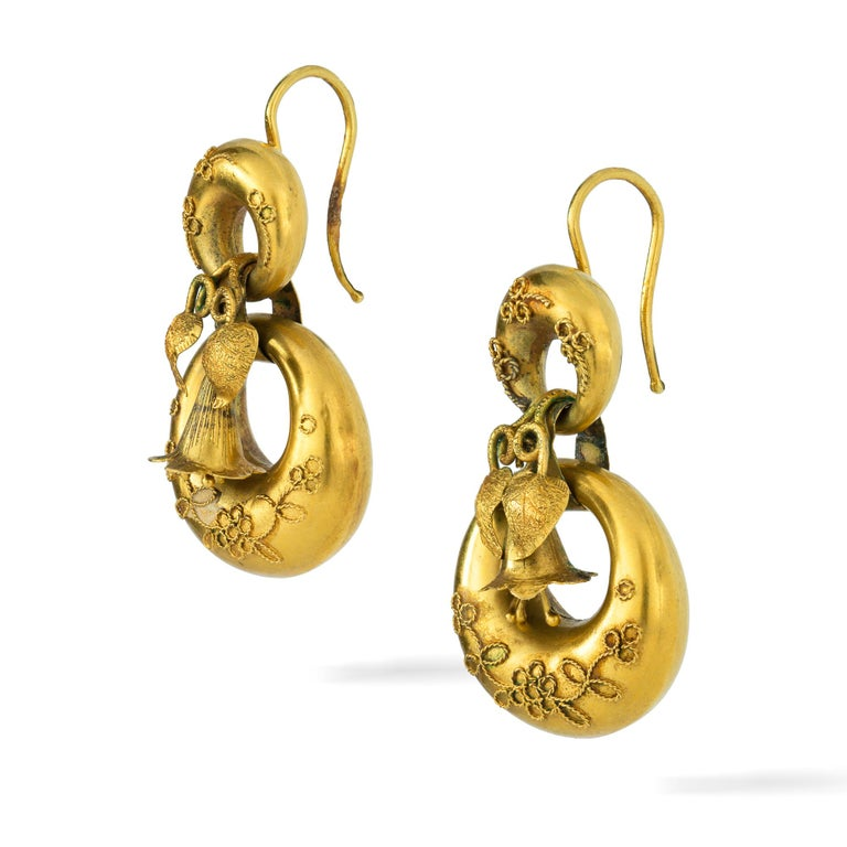 A pair of Victorian yellow gold earrings, in the form of two domed circlets with wirework decorations, linked by delicately-carved lily-of-the-valley and leaf decorations, all in yellow gold with hook fittings,  circa 1860, measuring approximately