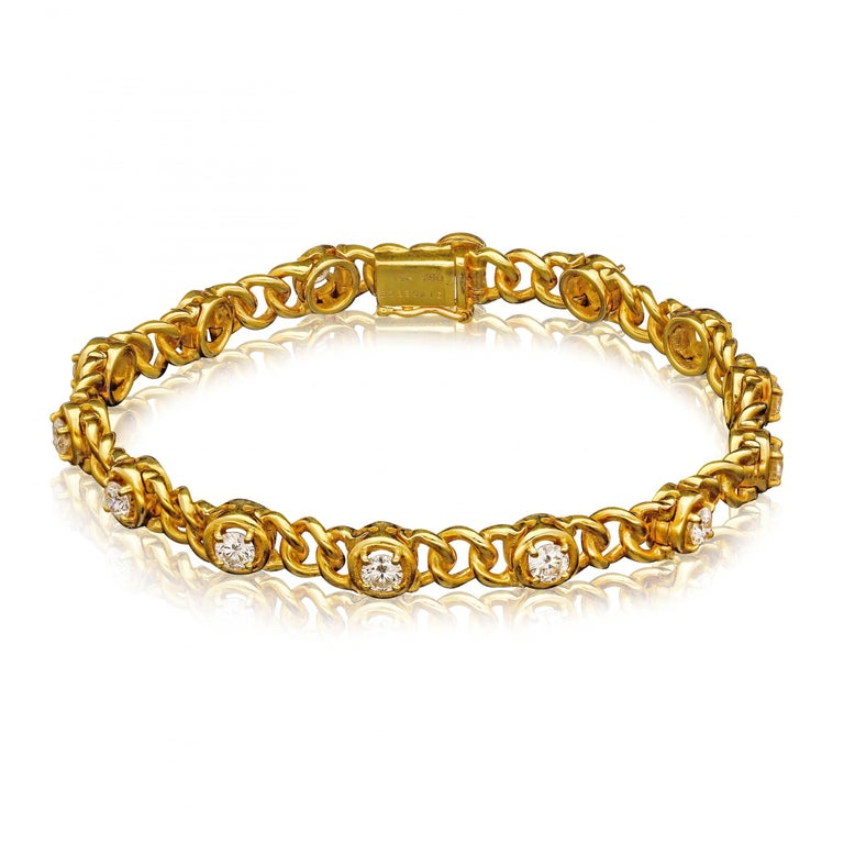 A pair of matching vintage gold and diamond bracelets by Van Cleef & Arpels c.1970s, each 18ct yellow gold bracelet with uniform circular links set with fourteen round brilliant cut diamonds in claw settings encircled with gold, spaced evenly along