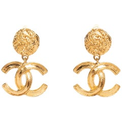 A Pair of Vintage Gold-Toned Chanel '95 Logo Dangle Clip-On Earrings