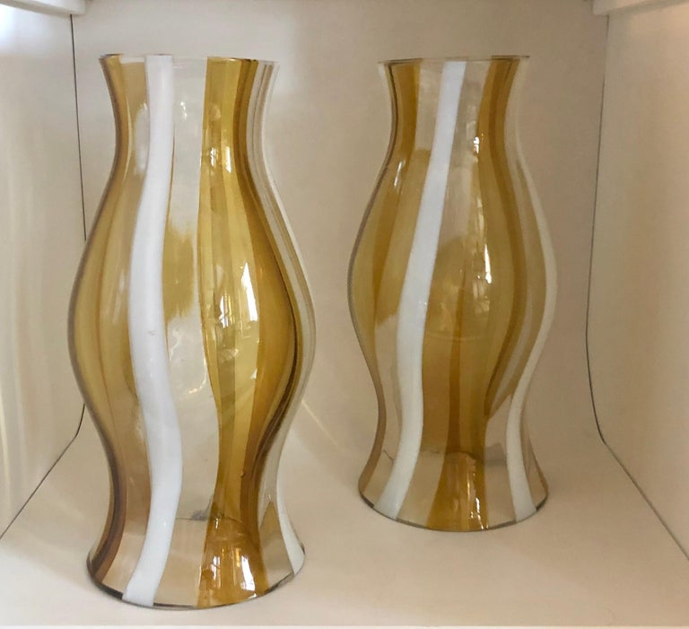 The glass with bands of light amber yellow, white and clear stripes.