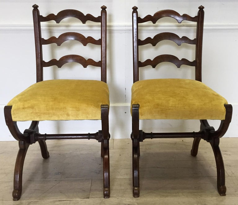 A very pretty and unusual pair of walnut side chairs attributed to Howard & Sons.