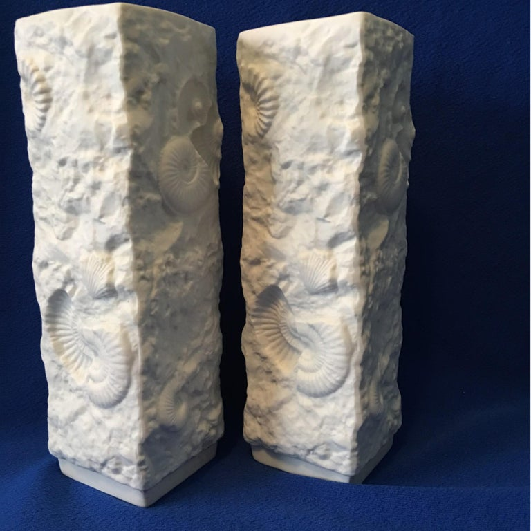 A lovely grand pair of white matte porcelain white fossil rock vases from the manufacture of Kaiser of Germany. Great looking set of attractive vases. Real eye catchers.