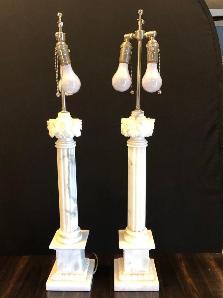 A pair of white and grey veined column marble table lamps with custom shades.