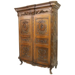 Palatial Late 18th Century Louis XVI Hand Carved Walnut and Mahogany Armoire