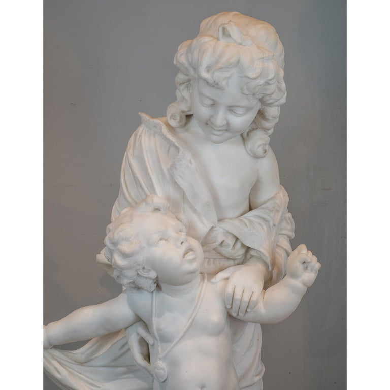 Carved White Marble Statue of Young Children by Paolo Folchi For Sale