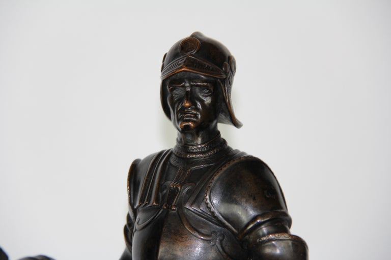 Patinated Bronze Figure of a Soldier on a Horse with a Helmet For Sale 5